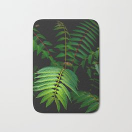 Illuminated Fern Leaf In A Dark Forest Background Bath Mat
