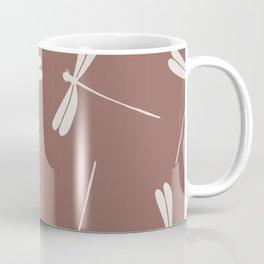 White Dragonflies against dark brown background.  Coffee Mug