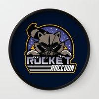 rocket raccoon Wall Clocks featuring Rocket Raccoon logo by Buby87
