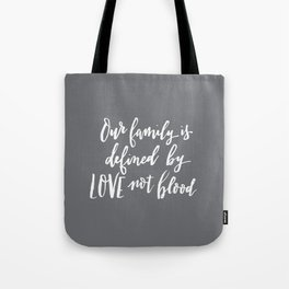 Our family is defined by LOVE not blood - hand lettered brush script white on gray Tote Bag