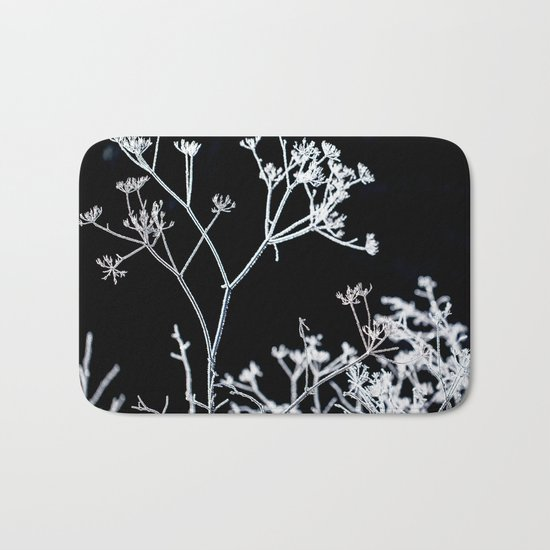 Frosted plant at cold winter day on black background Bath Mat