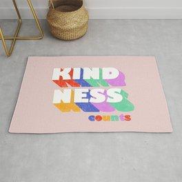 Kindness counts - rainbow typography Rug