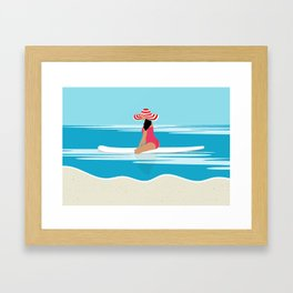 Solo surfing woman Framed Art Print