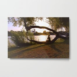 Beautiful nature, guy sitting on a curved tree on sunset Metal Print