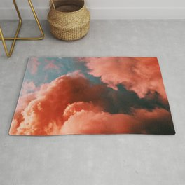 Orange and blue abstract clouds Rug