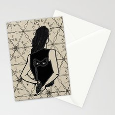 woman holding mask in back Stationery Cards