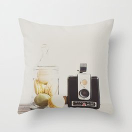 a vintage kodak brownie camera with delicious french macarons Throw Pillow