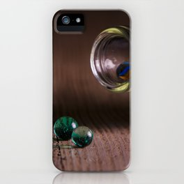 Marbles on the table iPhone Case