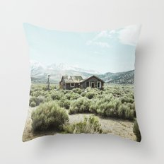 Old house in desert Throw Pillow