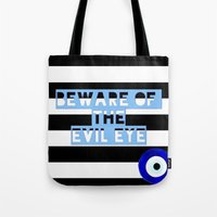 evil eye Tote Bags featuring evil eye by Iris & Ino