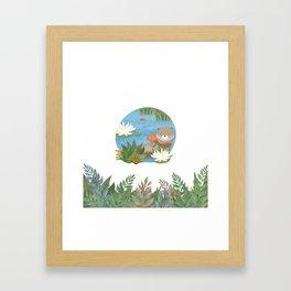 Otter in the forest Framed Art Print