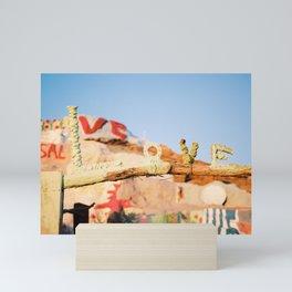 Love in Salvation Mountain, Slab City, CA. Film & digital photography wall art from Palm Springs, California. Art Print Mini Art Print
