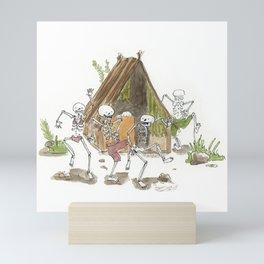 Cute skeleton kids dancing around a hut Mini Art Print