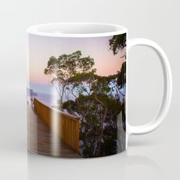 Sitting on the dock of the cliff Coffee Mug