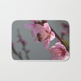 Honey Bee Feeding on Peach Tree Blossom Bath Mat