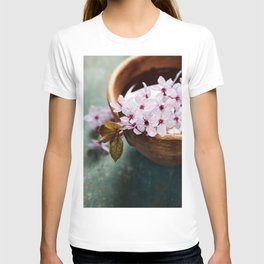 spring flowers for spa and aromatherapy over wooden background T-shirt
