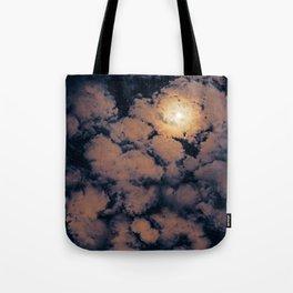 Full moon through purple clouds Tote Bag
