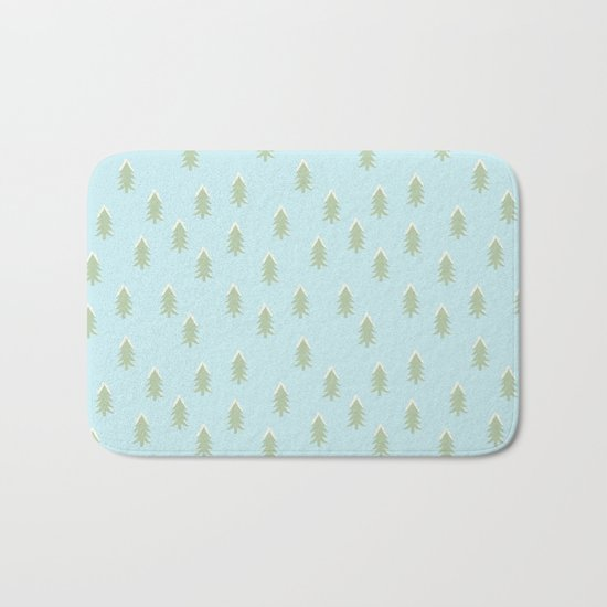 Merry christmas- With snow covered x-mas trees pattern on aqua backround Bath Mat