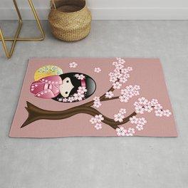 Japanese Spring Kokeshi Doll on Pink Rug