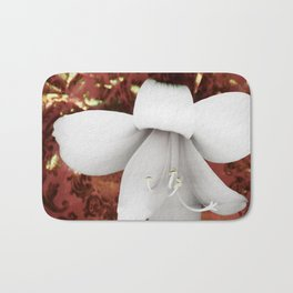 Innocent in copper red Bath Mat