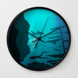 Beautiful coral reef and silhouettes of diver and school of fish in a blue sea Wall Clock