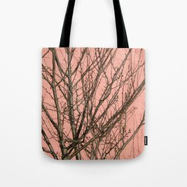 Bare tree against a pink wall Tote Bag