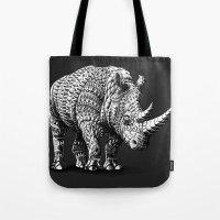 bioworkz Tote Bags featuring Rhinoceros by BIOWORKZ