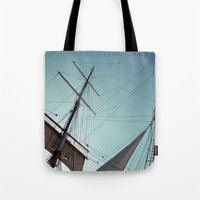 pirate ship Tote Bags featuring Pirate Ship by Amanda Novocin Bee
