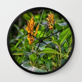 Yellow flower in the rain forest Wall Clock