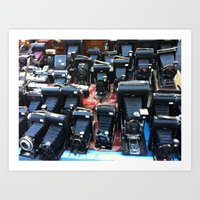 cameras Art Prints featuring Cameras by Irma