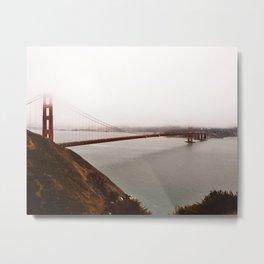 Golden Gate Bridge shrouded in Clouds Metal Print