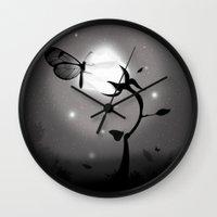 mandie manzano Wall Clocks featuring Recharging by Fabian Gonzalez