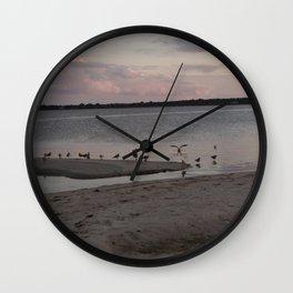 Birds at sunset Wall Clock