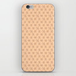 brown flowers on peach background iPhone Skin