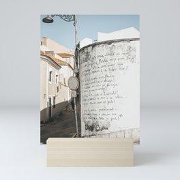 Talking walls of Lisbon on street corner column   Portugal travel wall art to inspire, Saige Ashton Prints Mini Art Print