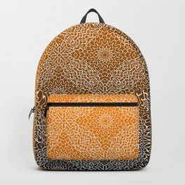 Detailed, lace like mandala pattern in white with gradient black and orange background Backpack