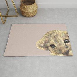 peeping lion cub Rug