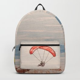 Paragliding along the beach  Backpack