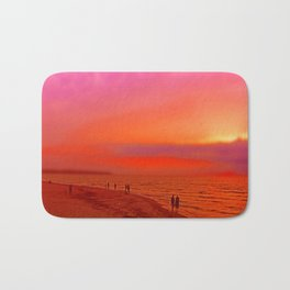 Sunset in orange and pink by the beach Bath Mat