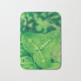Clover leaf in the rain Bath Mat