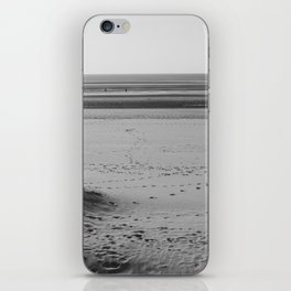 Beach in winter with some walkers iPhone Skin