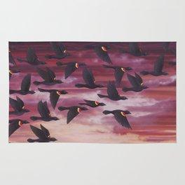 red-winged blackbird flock in flight Rug