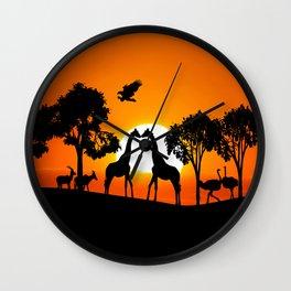 Giraffe silhouettes at sunset Wall Clock