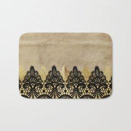 Elegance- Ornament black and gold lace on grunge paper backround Bath Mat