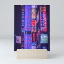 Neon kanji in tokyo Mini Art Print