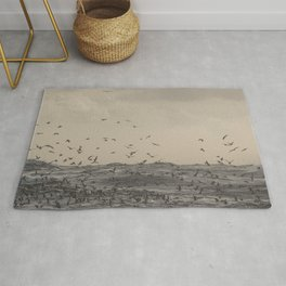 Seagulls over the stormy sea Rug