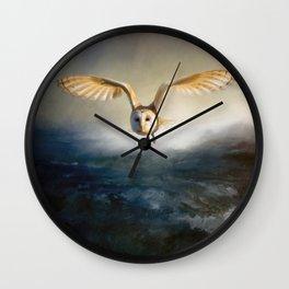 An owl flies over the lake Wall Clock