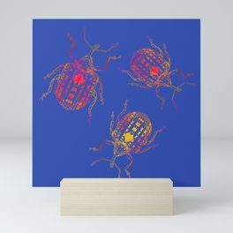 3 colorful snout beetles Mini Art Print