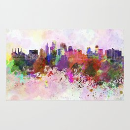 Kansas City skyline in watercolor background Rug
