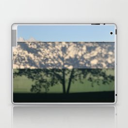 Shadow Tree on an industrial building Laptop & iPad Skin